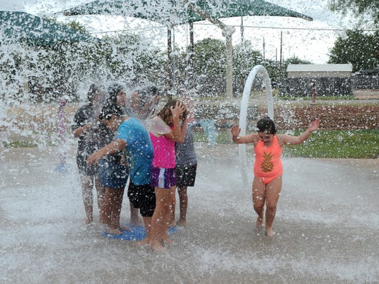 Children play in the Scarborough Park splash pad in 2016.