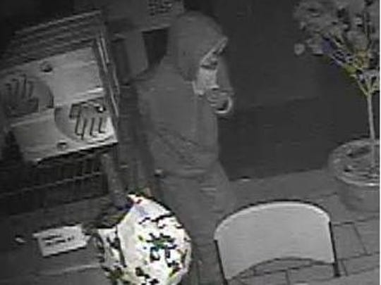 One of two men who allegedly stole two safes from a Warren yogurt shop.