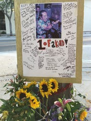 """Messages of condolence are seen on a memorial for Chingchai """"Chang"""" Liampetchakul, the longtime owner of Tipps Thai Cuisine in downtown Ventura. The display appeared in front of the former restaurant within hours of the restaurateur's death on Aug. 1. He had been facing arson charges in connection with a fire at the restaurant building in April 2017."""