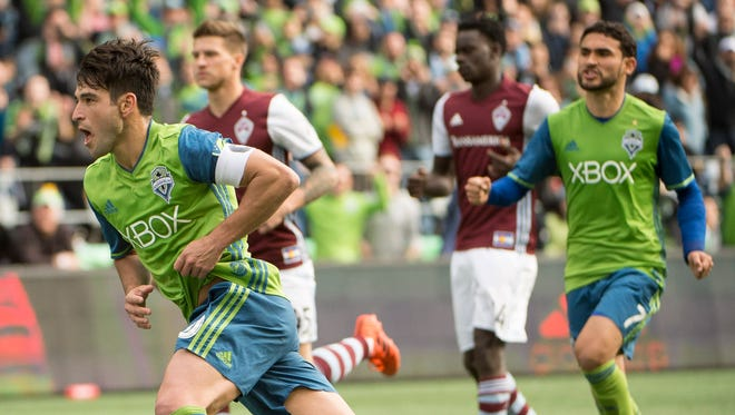 Nicolas Lodeiro (10) celebrates after scoring a goal on a penalty kick against the Colorado Rapids at CenturyLink Field.