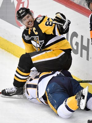 Pittsburgh Penguins center Sidney Crosby (87) lands on top of Nashville Predators defenseman P.K. Subban (76) during a scuffle in the first period of game 5 of the Stanley Cup Final at PPG Paints Arena Thursday, June 8, 2017, in Pittsburgh, Pa.