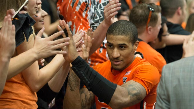 Oregon State guard Gary Payton II (20) celebrates with fans after Senior Day at Gill Coliseum. The Beavers defeated Washington State, 69-49 on Feb. 28, 2016.