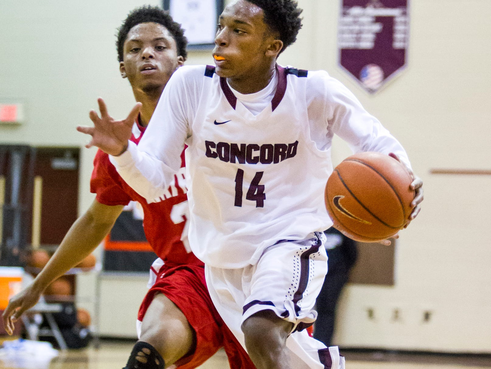 Concord's Craig Brady drives past Smyrna's Ja'vier Worthy at Concord High School on Tuesday evening. Concord defeated Smyrna 50-44.