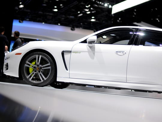A Porsche is displayed Tuesday, Jan. 12, during the North American International Auto Show at Cobo Hall.