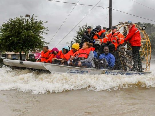 In late August, volunteers and first responders work