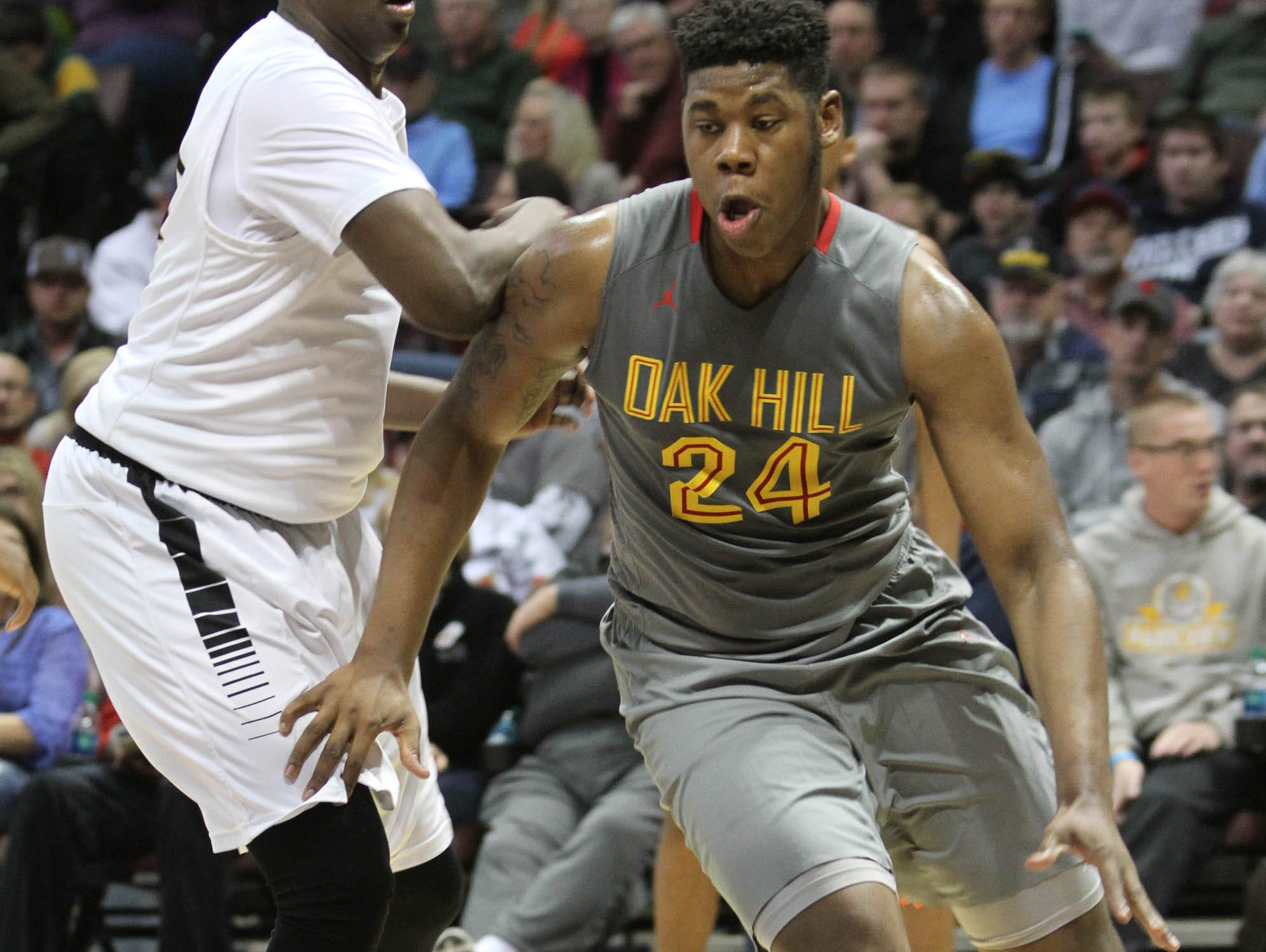 Oak Hill Academy (Mouth of Wilson, Virginia) forward Joe Hampton, right, scored 14 points in the Warriors' 82-59 win over Wesleyan Christian (High Point, North Carolina) in the final of the 2015 Bass Pro Tournament of Champions at JQH Arena in Springfield.