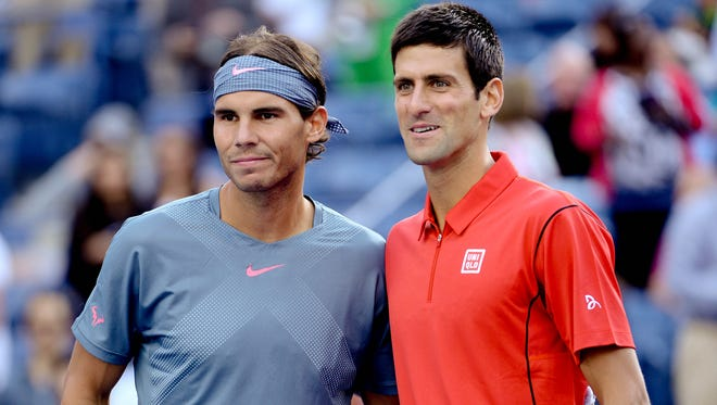 Rafael Nadal poses for a photo with Novak Djokovic before the 2013 US Open men's singles final.