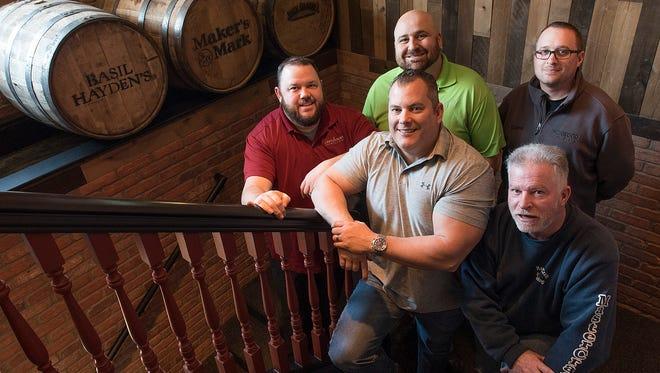 The partners are: Landon Garrett II, Dan Johnson, Phil Zakaria, Joe Comiskey, and Duane Fox.