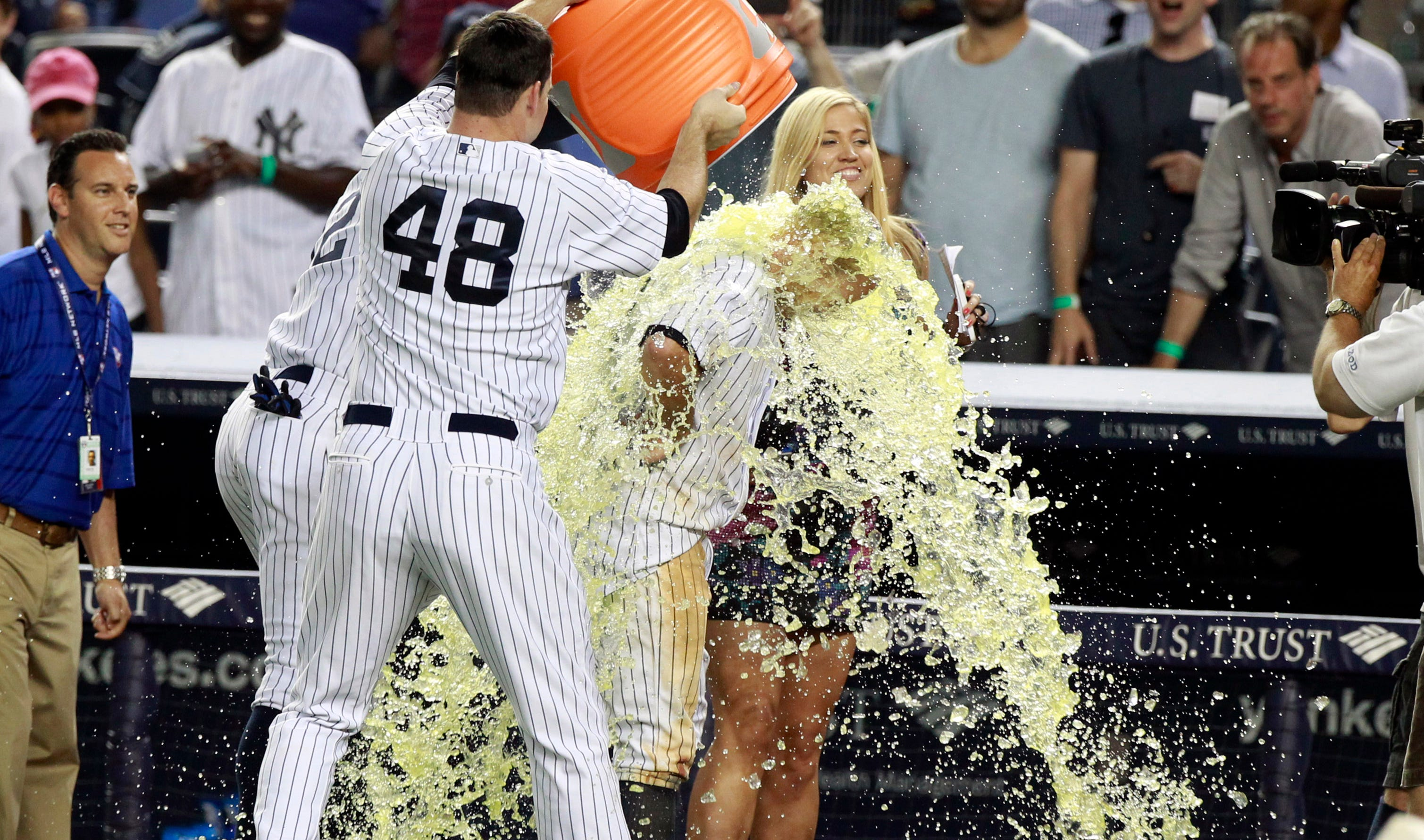 Aug.  9: Yankees relief pitcher Boone Logan  throws the Gatorade jug over center fielder Brett Gardner after his game-winning hit against the Tigers.