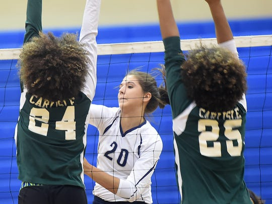 Chambersburg's Caitlin Vrabel (center) smacks a kill around a pair of Carlise defenders earlier this season. Vrabel set herself apart as one of the top hitters in the Mid Penn Commonwealth Division and is the Public Opinion Girls Volleyball Player of the Year.