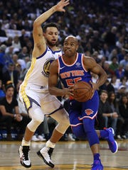 New York Knicks' Jarrett Jack, right, drives the ball against Golden State Warriors' Stephen Curry during the first half of an NBA basketball game Tuesday, Jan. 23, 2018, in Oakland, Calif. (AP Photo/Ben Margot)