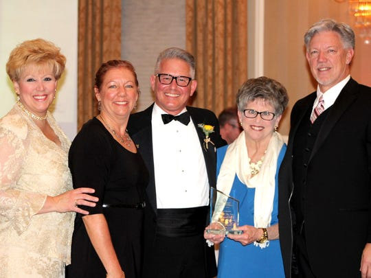 2016 York Heart Ball co-chair Steven Alwine, center, presents the award for Company of the Year, on behalf of the York Division of the American Heart Association, to Hanover Hospital.  Pictured, from left, are: Tanya Lynne, Lisa Duffy, Steven Alwine, Pat Saunders, and Michael Hockenberry.
