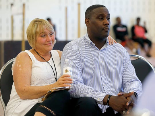 Kathy and Carlton Valentine, parents of the Chicago Bulls' first round draft pick and former MSU and Sexton star Denzel Valentine, listen during Monday's Bulls press conference introducing their son.