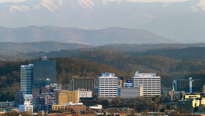 Snow-covered Thunderhead Mountain towers over Knoxville and the Tennessee Valley on Feb. 13, 2016, as seen from Sharp's Ridge Memorial Park. At an elevation of 5,527 feet, Thunderhead is 4,641 feet higher than Knoxville.
