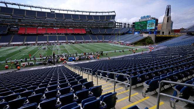 The New England Patriots and the Las Vegas Raiders play in an empty Gillette Stadium due to the coronavirus pandemic in the second half of an NFL football game, Sunday, Sept. 27, 2020, in Foxborough, Mass.