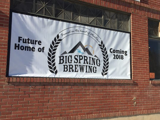 A sign promises this building is the future home of Big Spring Brewing.