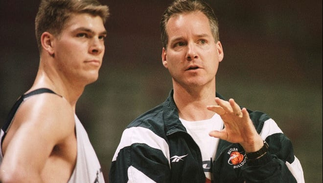 Butler Coach Barry Collier confers with Jon Neuhouser during practice Wednesday March 12 1997 in Auburn Hills Michigan.