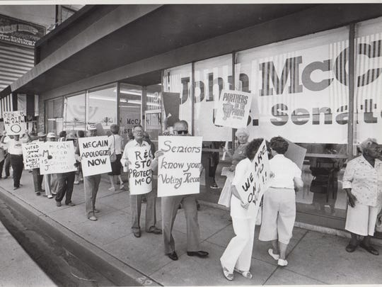 A group of senior citizens, irate over a remark made by Rep. John McCain, R-Ariz., display placards at his campaign office in Phoenix on July 8, 1986.
