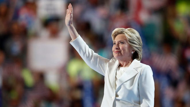Democratic presidential nominee Hillary Clinton waves after taking the stage during the final day of the Democratic National Convention in Philadelphia , Thursday, July 28, 2016. (AP Photo/Paul Sancya)