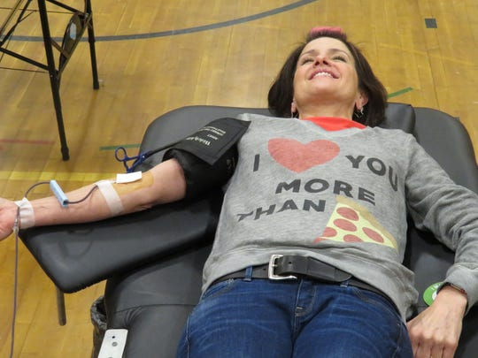 Sheri Meminger Broadus, an attendance clerk at South Hill Elementary School, donates blood. Meminger Broadus, who knows how much Jones-Williamson loves pizza, said she loves Sarah more than her love for pizza.