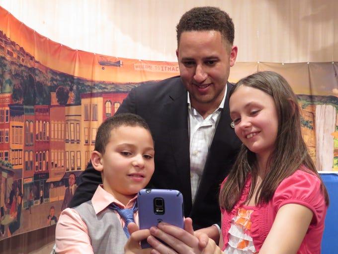 Zolan Stern, 9, and Kayla Rink, 9, take a selfie with