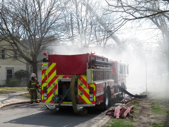 Smoke from a house fire is seen on South Titus Avenue.