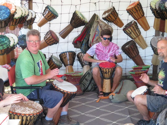 Vendors played the bongos as festivalgoers pass by