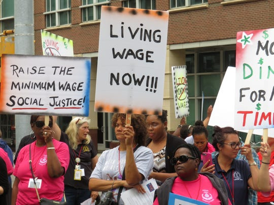 """People at the rally to increase the minimum wage said a variety of chants, including """"Let Tompkins live."""""""