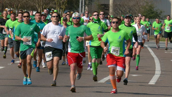 Runners in a past McGuire's St. Patrick's Day 5K Prediction Run approach the finish line.