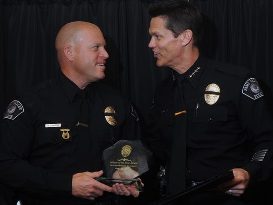 Simi Valley Police Officer Robert Longdon, left, is