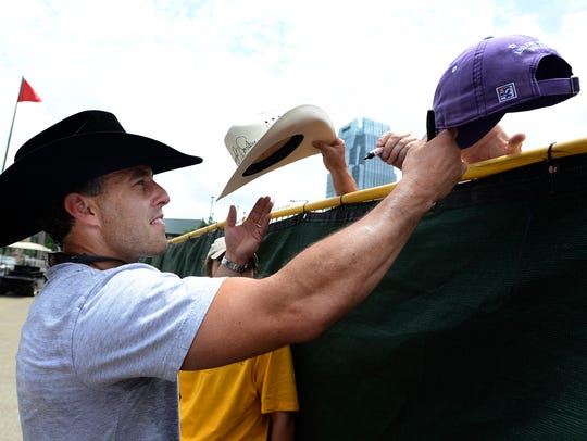 Aaron Watson signs autographs for fans after performing at the CMA Music Festival.