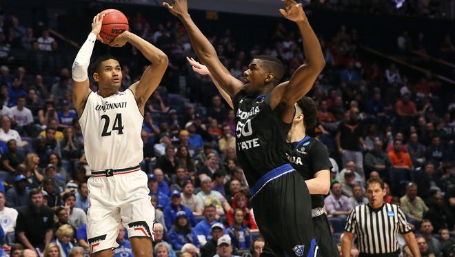 Cincinnati Bearcats forward Kyle Washington (24) rises for a shot in the first half of the first-round NCAA Tournament game between the Cincinnati Bearcats and the Georgia State Panthers, Friday, March 16, 2018, at Bridgestone Arena in Nashville.