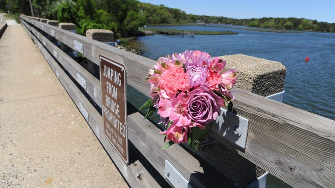 Flowers were placed on Highbank Road bridge after a 15-year-old boy jumped into the water on a group outing in May and drowned. Highbank is one of three bridges in Dennis where jumping is banned, and an article on the fall town meeting warrant seeks to extend that ban to all 14 bridges in town.