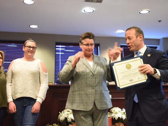 Congressman Josh Gottheimer administers Oath of Office to newly elected committee member Linda Boniface.
