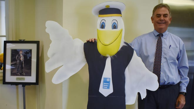 Marine Bank and Trust President Bill Penney stands with a cutout of mascot Mariner Pete at their main branch located at 571 Beachland Blvd. in Vero Beach.