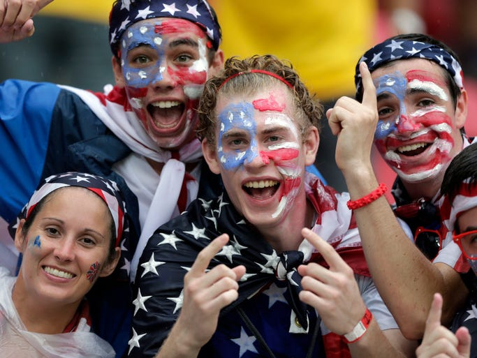US fans cheer prior to the group G World Cup soccer match between the USA and Germany at the Arena Pernambuco in Recife, Brazil, Thursday, June 26, 2014. (AP Photo/Matthias Schrader)