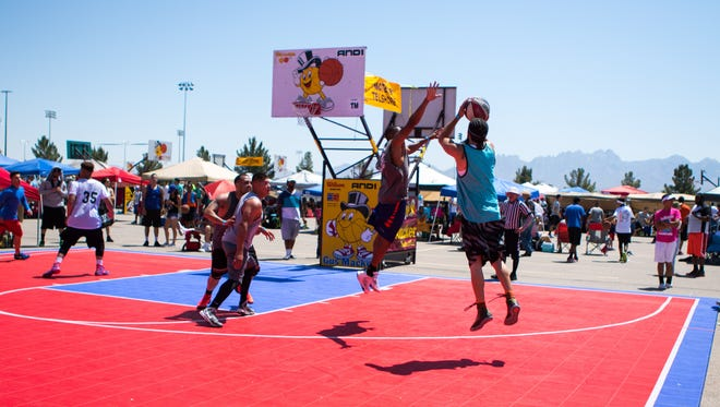 Top Mens bracket action at the Gus Macker 3 on 3 basketball tournament.
