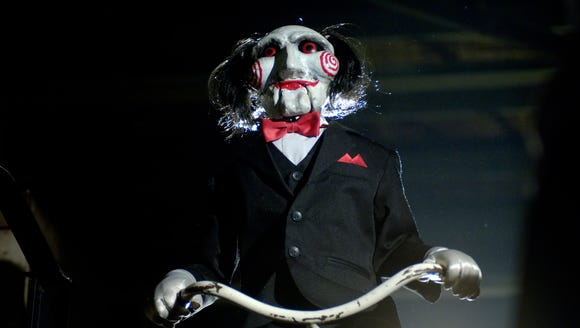 Billy the Puppet is usually around to deliver disturbing