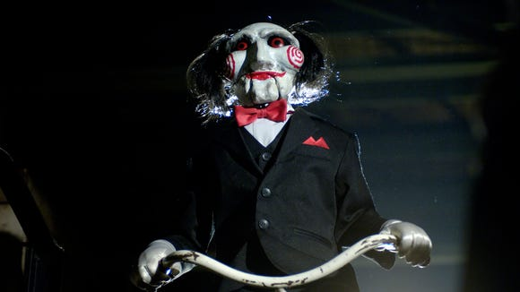 Billy the Puppet is usually around to deliver disturbing news in movies like 2005's 'Saw II.'
