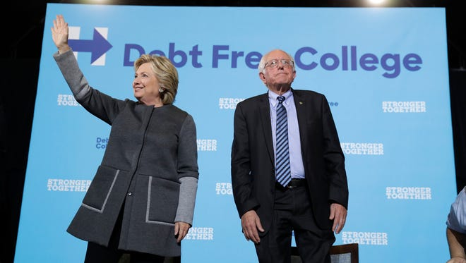Hillary Clinton and Bernie Sanders make a campaign stop at the University of New Hampshire in Durham, N.H., on Sept. 28, 2016.