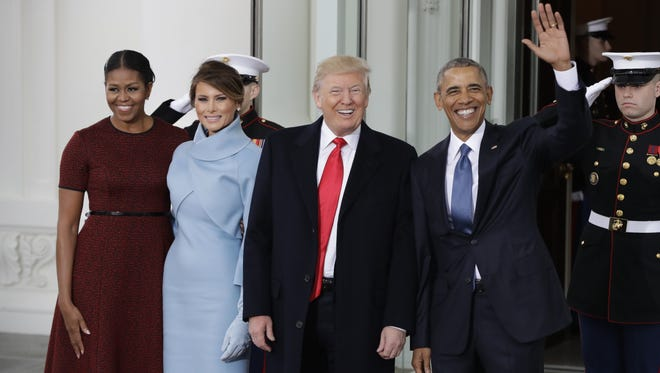 President Barack Obama and first lady Michelle Obama greets President-elect Donald Trump and his wife Melania Trump at the White House in Washington, Friday, Jan. 20, 2017. (AP Photo/Evan Vucci)