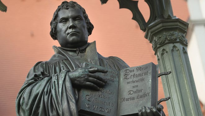 A statue of 16th-century theologian Martin Luther stands on Marktplatz square in Wittenberg, Germany.