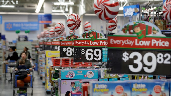 FILE - This Wednesday, Oct. 26, 2016, file photo, shows prices in the toy section at Walmart in Teterboro, N.J. With shoppers moving more seamlessly between stores and mobile devices, retailers are trying to find a balance between investing in both.