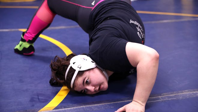 Moody High School wrestler Kacie Rodriguez stretches Thursday, Jan. 18, 2018. Rodriguez is ranked in the top 10 in the country in her weight class.