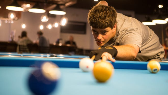Robert Blackiston plays pool at the Slate Cafe in Smyrna Monday, July 16, 2018. Blackiston and others will be traveling to Las Vegas for the American Poolplayers Association World Pool Championships at the Westgate Las Vegas Resort & Casino in August.