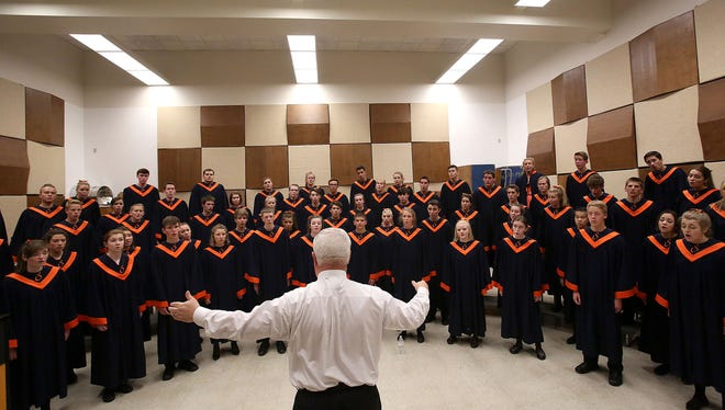 Sprague High School warms up before there performance at the OSAA State Choir Championships at George Fox University on Saturday, May 9, 2015, in Newberg, Ore.
