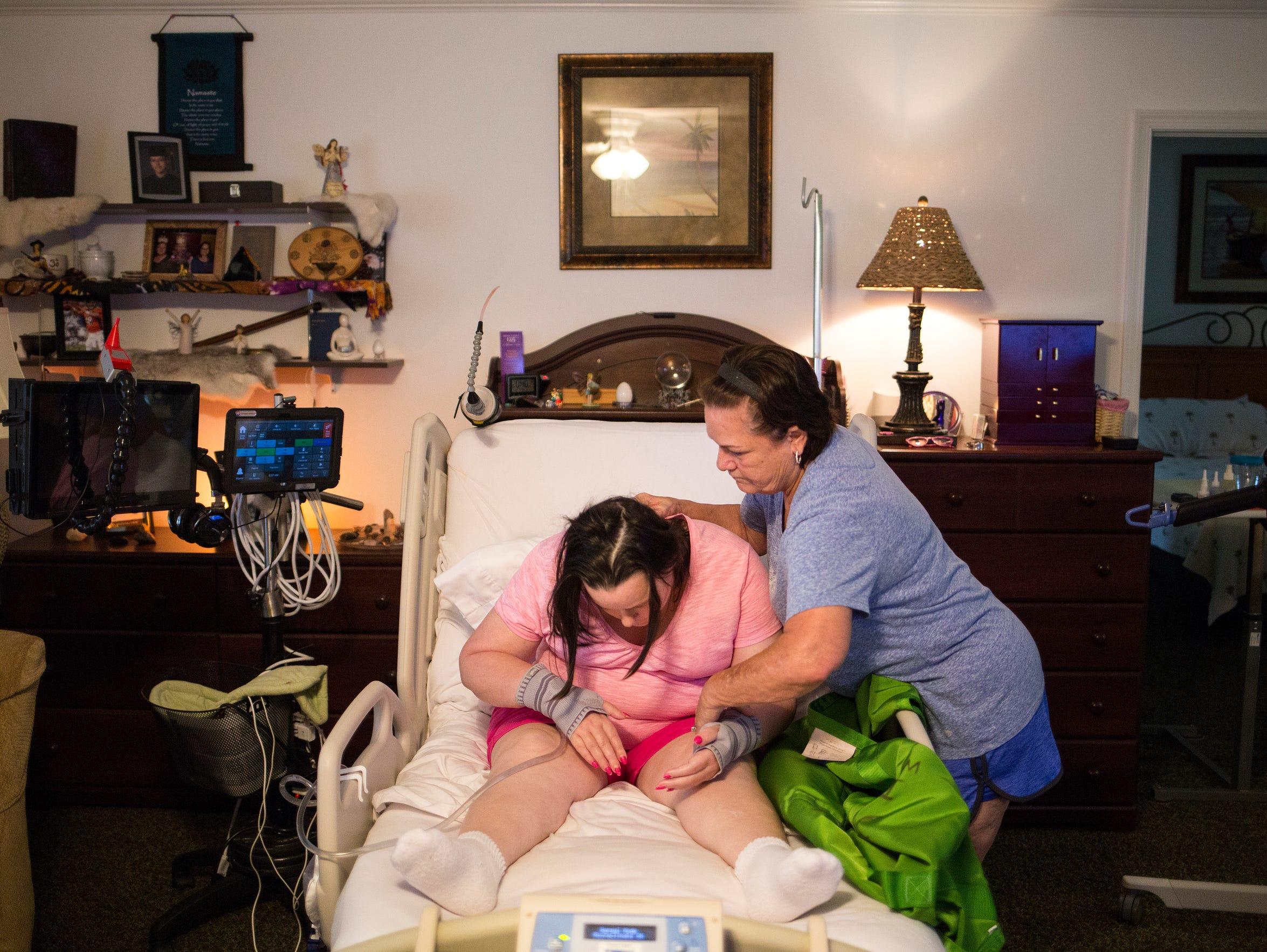 Renee Whisner's mother, Mimi Treadway, helps adjust