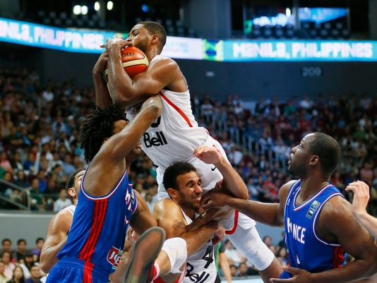 Canada's Tristan Thompson leaps high for a rebound during their finals basketball match in the FIBA Olympic Qualifying basketball match against France Sunday, July 10, 2016 at the Mall of Asia Arena in suburban Pasay city south of Manila, Philippines. (AP Photo/Bullit Marquez)