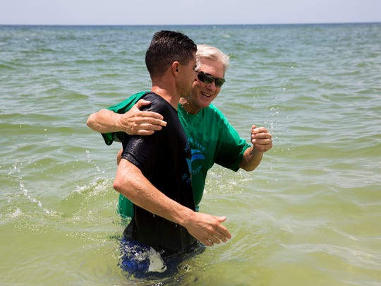 "Senior Pastor Hayes Wicker baptizes 16 people alone during the beach baptism ceremony at La Mer Condominiums Sunday, August 6, 2017 in Naples. ÒThere seems to be, to me, a greater sense of joy and excitement getting outdoors,"" Wicker said. ""People love it because theyÕre pleasing God and we're in the midst of his creation."" Wicker, a pastor at First Baptist Church of Naples since 1992, helped to start the beach baptism ceremonies immediately after his arrival."