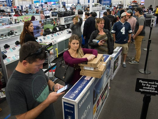 People buy TVs at Best Buy on Thanksgiving after the